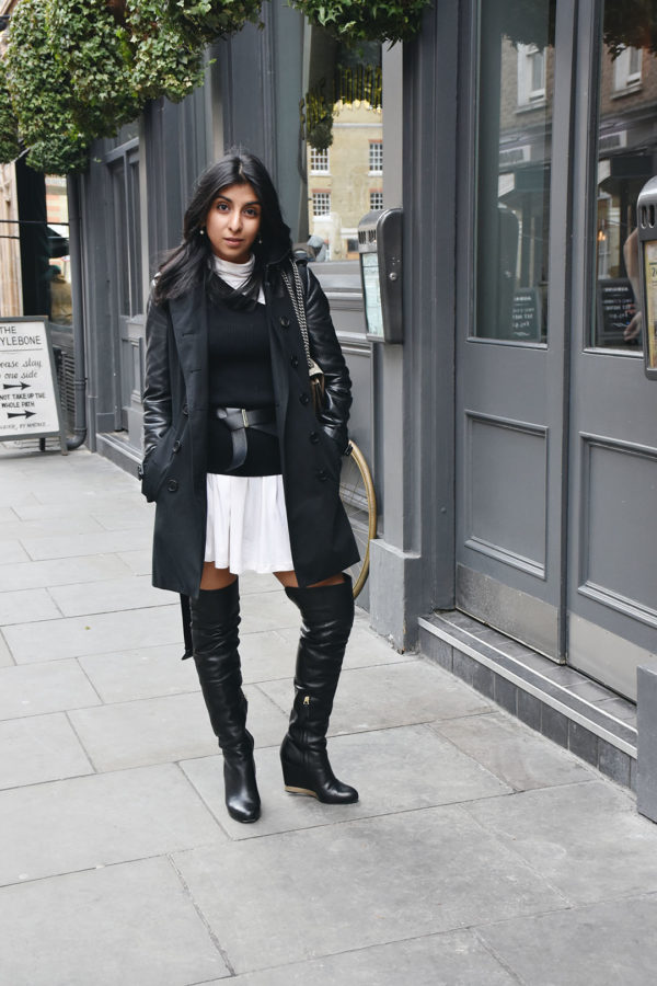 Fashion blogger Shloka Narang of The Silk Sneaker shows how to layer a dress this winter in an ASOS dress and Whistles Sweater