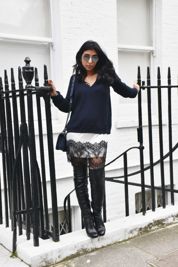 Fashion blogger Shloka Narang of The Silk Sneaker wears a Brandy Melville Sweater and Topshop Lace Slip dress to show how to layer this winter