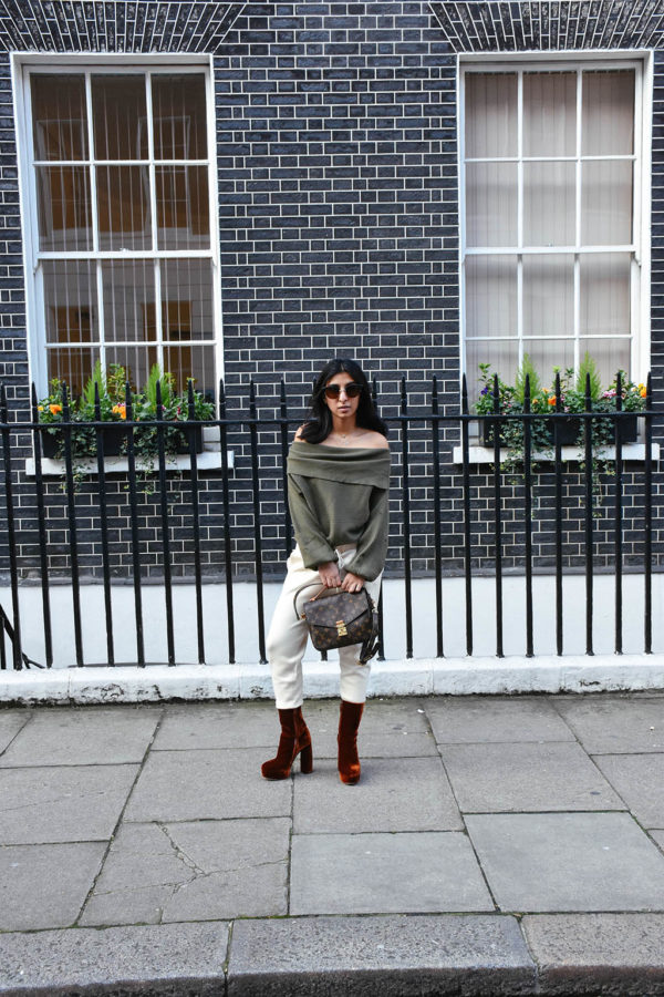 Fashion blogger Shloka Narang of The Silk Sneaker shows how to dress for spring with an off shoulder Zara sweater and Louis Vuitton Pochette Bag