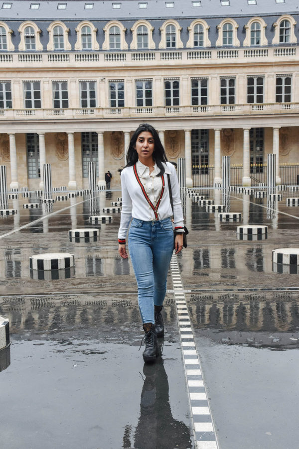Fashion blogger Shloka Narang of The Silk Sneaker showcases a chic outfit in Paris featuring a Gucci Sweater