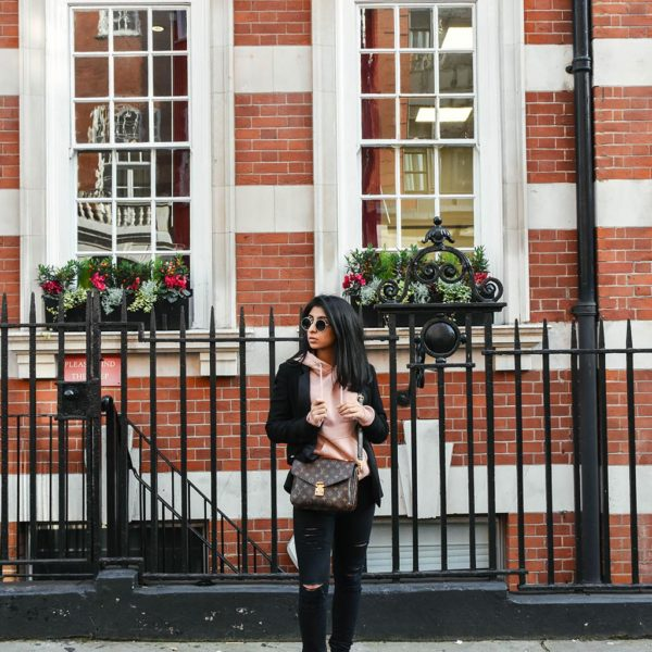 Fashion Blogger Shloka Narang of The Silk Sneaker showcases how to style a hoodie for everyday featuring Topshop hoodie and Frame Denim jeans