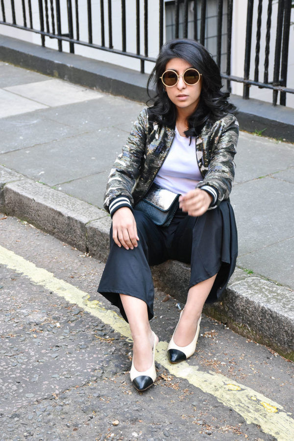 Fashion blogger Shloka Narang of The Silk Sneaker showcases how to wear sequins in the day featuring Topshop Bomber Jacket and ASOS pants