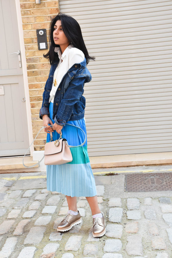 Fashion blogger Shloka Narang styles a maxi skirt outfit featuring a pastel colour block skirt and denim jacket