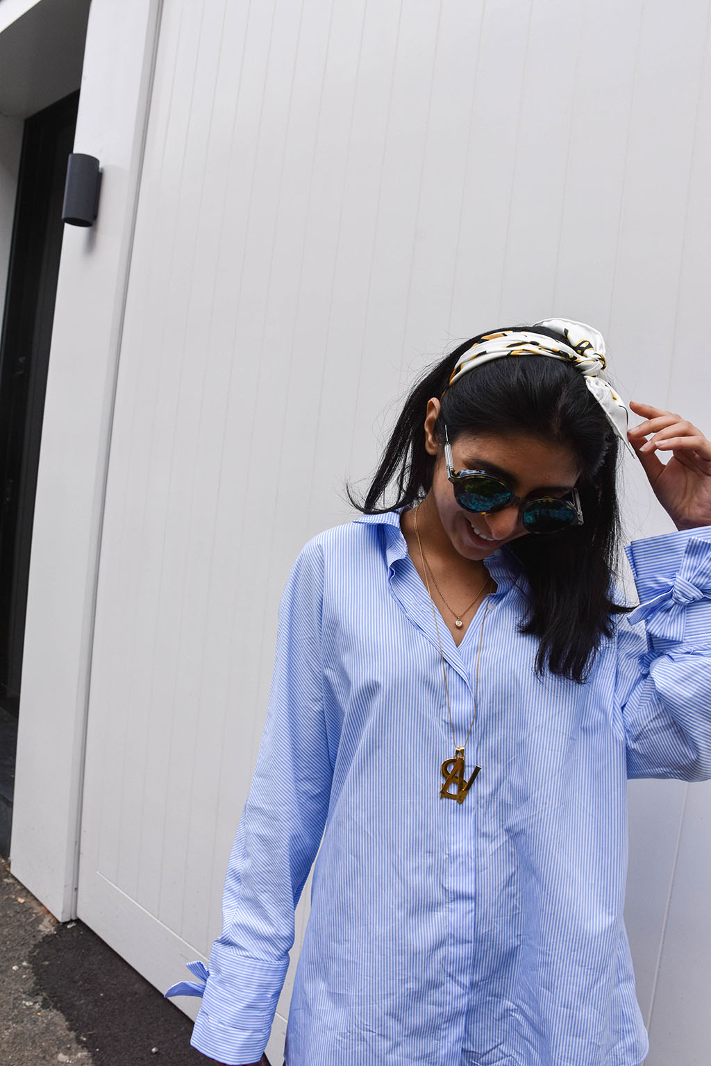 Fashion blogger Shloka Narang showcases how to use a scarf as a headband in the latest bandana hairstyle trend