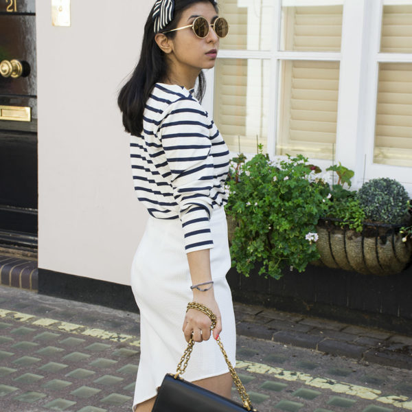 Fashion blogger Shloka Narang of The Silk Sneaker showcases how to wear a striped outfit for summer street style