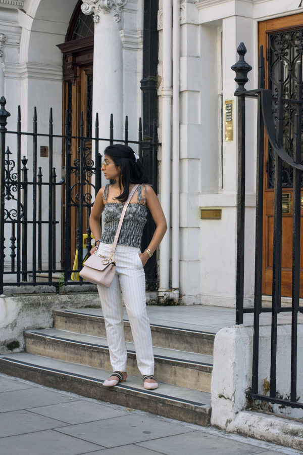 Fashion Blogger Shloka Narang of The Silk Sneaker showcases how to wear an easy summer outfit mixing gingham and stripes