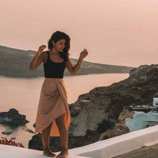 Fashion blogger Shloka Narang of The Silk Sneaker showcases how to look glamorous on your holiday with Wolford in Santorini