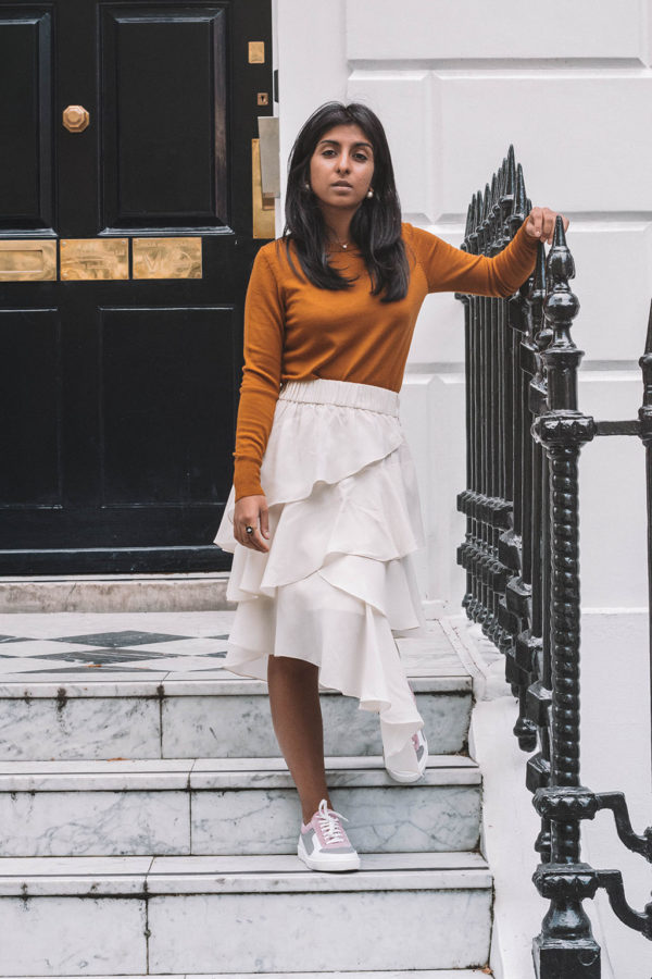 Fashion blogger Shloka Narang of The Silk Sneaker creates a stunning autumn outfit transitioning the summer skirt into autumn with Isabel Marant, Uniqlo and Amazon Find