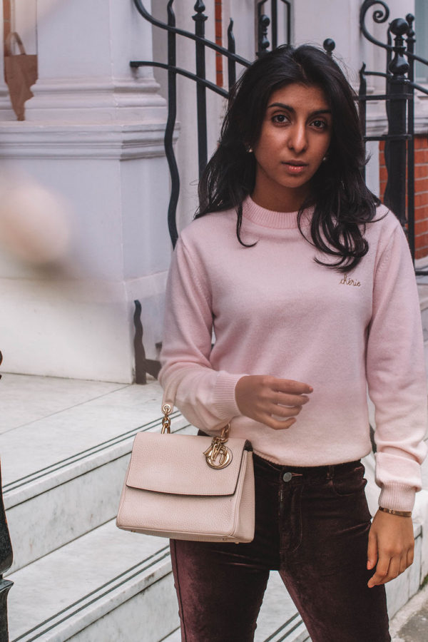 Fashion blogger Shloka Narang of The Silk Sneaker showcases how to style velvet pants in a winter outfit with Paige and Dior
