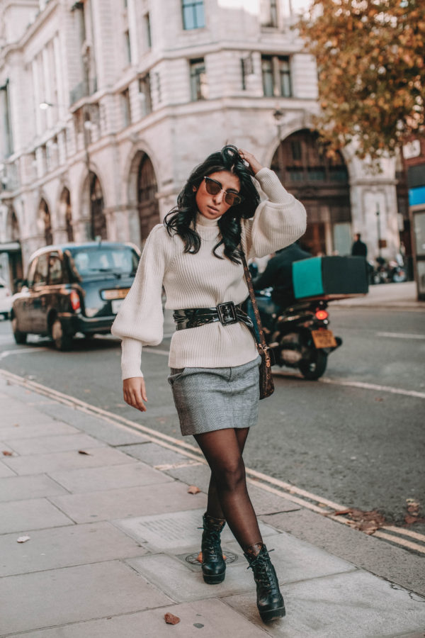 Fashion blogger Shloka Narang of The Silk Sneaker shares the must have sweater for 2018 in this sweater outfit idea
