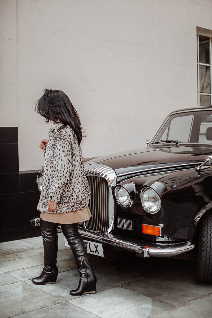 Fashion blogger Shloka Narang of The Silk Sneaker shares how to style a leopard print coat featuring By Malene Birger, Maje and Chanel