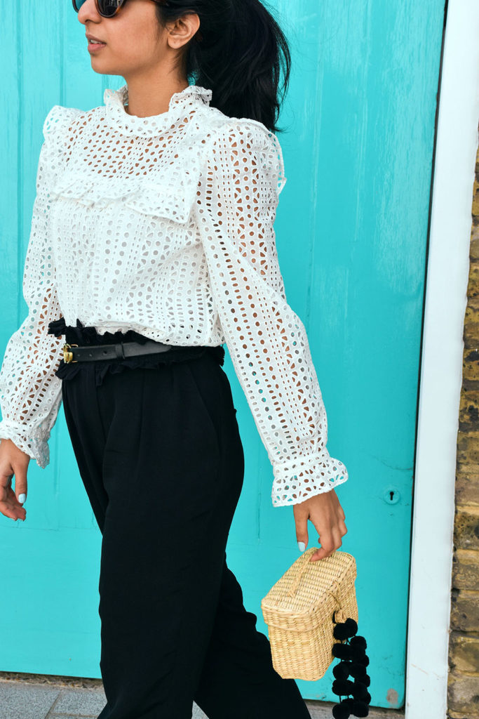 82b56748ec7 Fashion blogger Shloka Narang of The Silk Sneaker showcases how wear a lace  top for a
