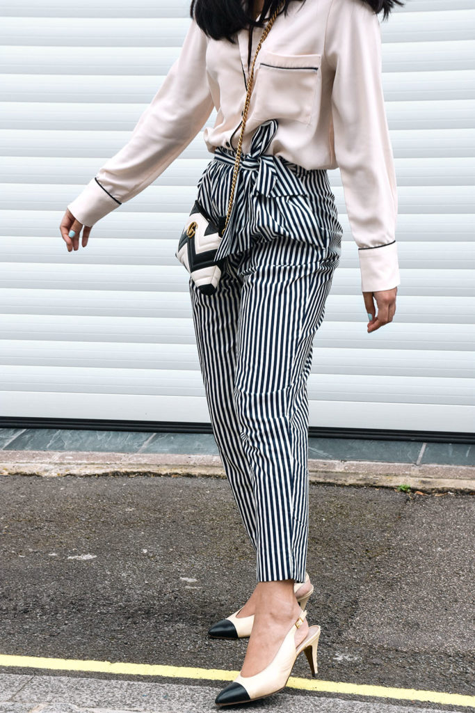 765ee7cf Fashion blogger Shloka Narang showcases how to style striped pants  featuring Topshop, Zara and Gucci
