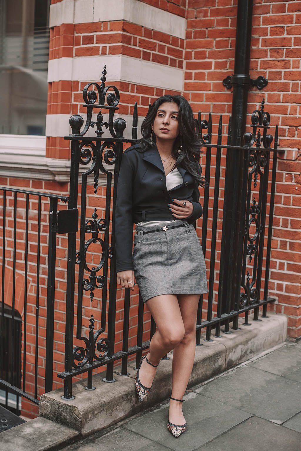 6d9643316 Fashion blogger Shloka Narang of The Silk Sneaker shares how to style a  plaid skirt to
