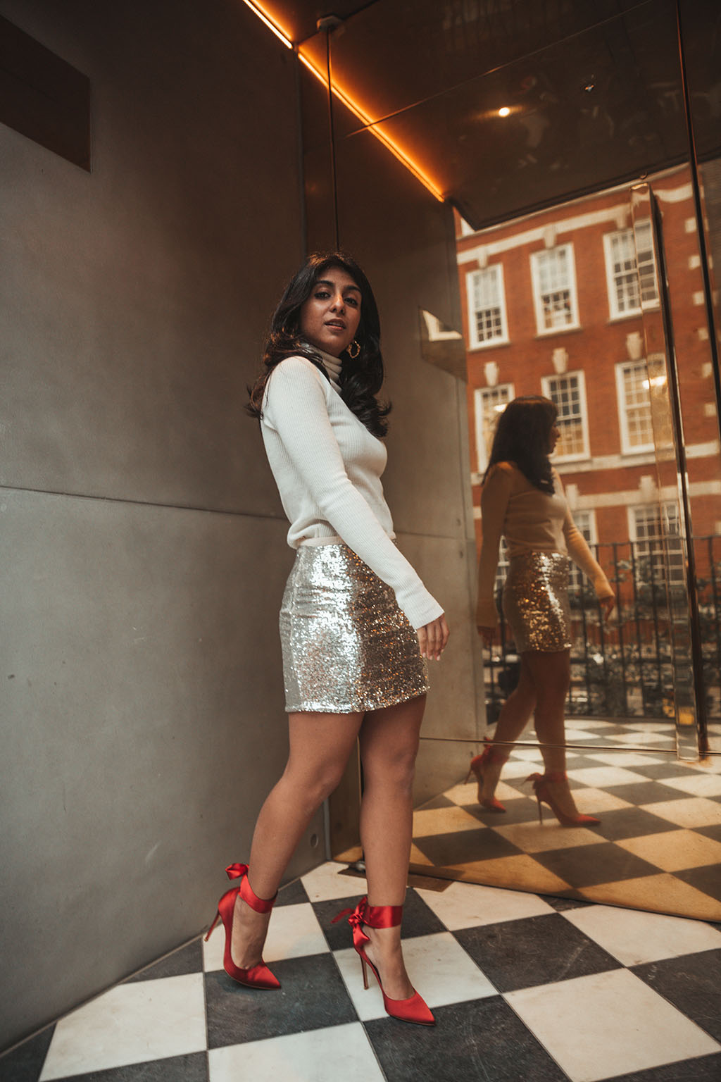 d644d8ac628d Luxury fashion blogger Shloka Narang of The Silk Sneaker shares a holiday  party outfit idea featuring